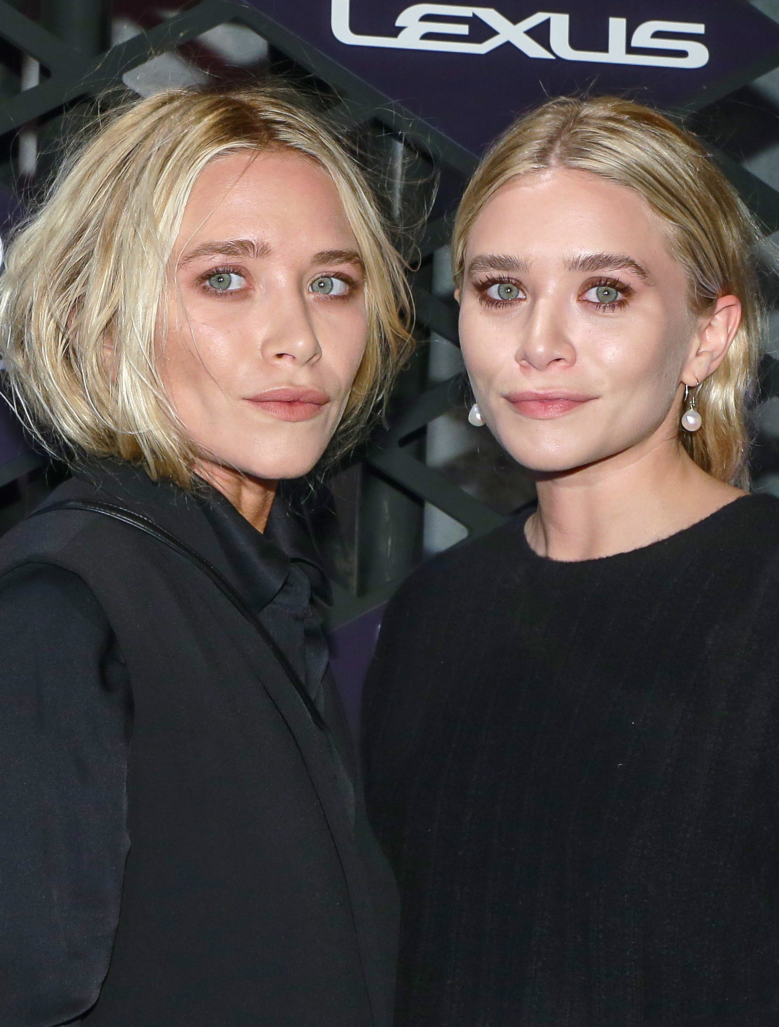Later in 2013, the pair rocked on-trend pink eye makeup at the Lexus Design Disrupted Event. Mary-Kate also changed up her style by wearing her blond hair tucked into her outfit.