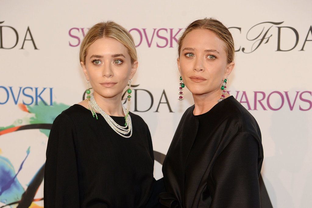 Ashley and Mary-Kate sported matching natural makeup and center-parted hairstyles at the 2014 CFDA Awards.