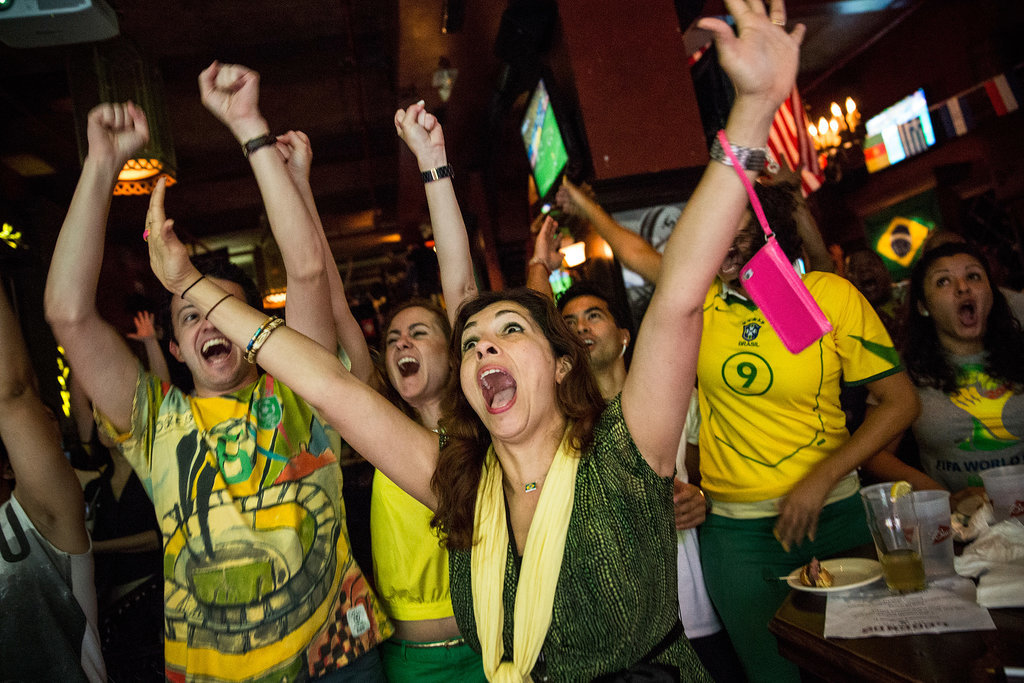 Brazilian soccer fans went wild watching the opening match at a bar in NYC.