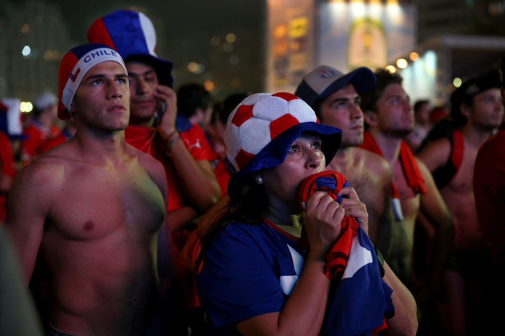 Chilean soccer fans watched their team play on a giant screen at Copacabana Beach in Brazil.