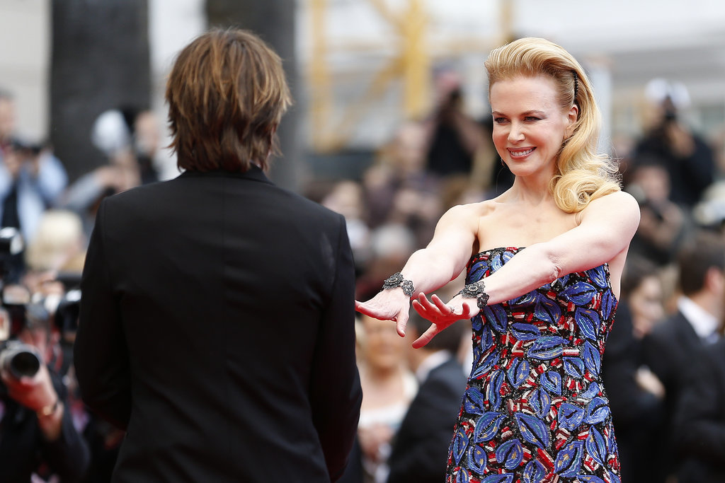 Nicole reached out for Keith's hands when they walked the red carpet at the Cannes Film Festival in May 2013.