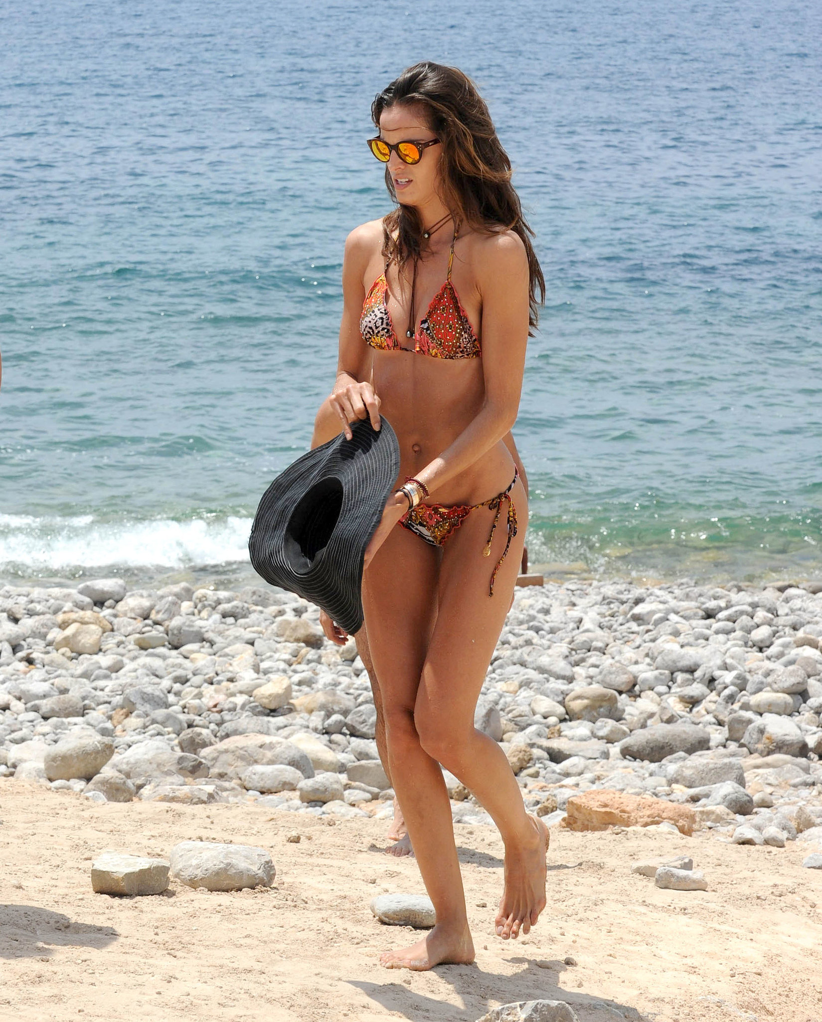 With her slim body and Regular brown hairtype without bra (cup size 33B) on the beach in bikini