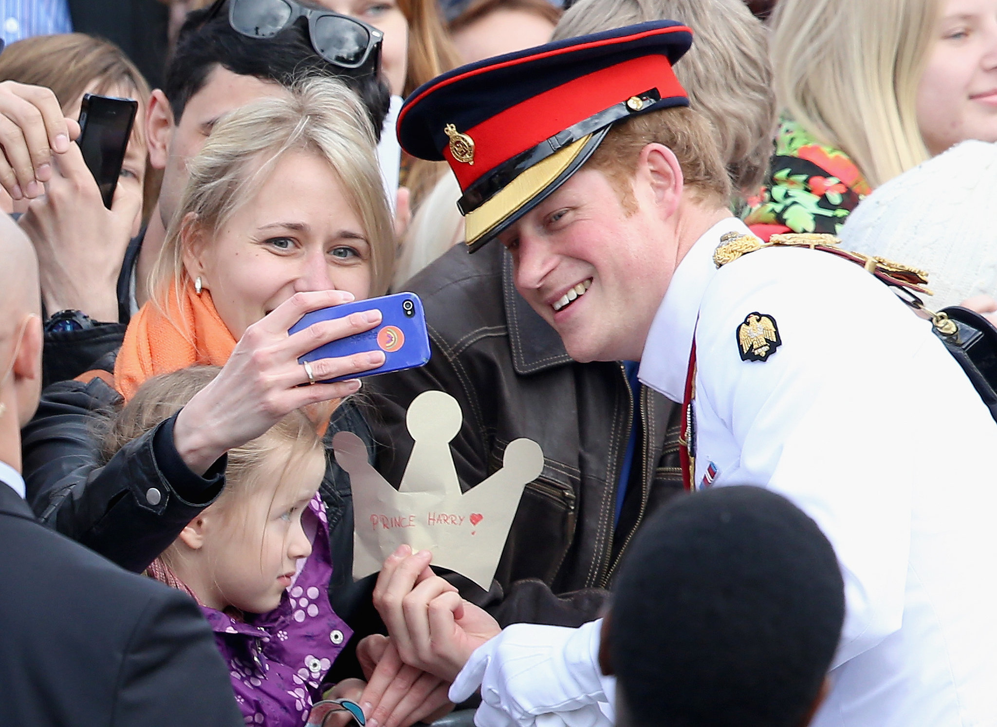 In May 2014, Prince Harry paused to take a selfie with a young woman in Estonia.