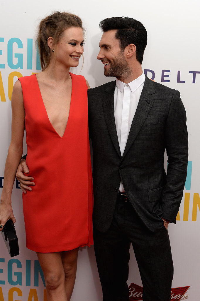 Adam Levine and his fiancée, Behati Prinsloo, shared a sweet moment at his Begin Again premiere in NYC on Wednesday.