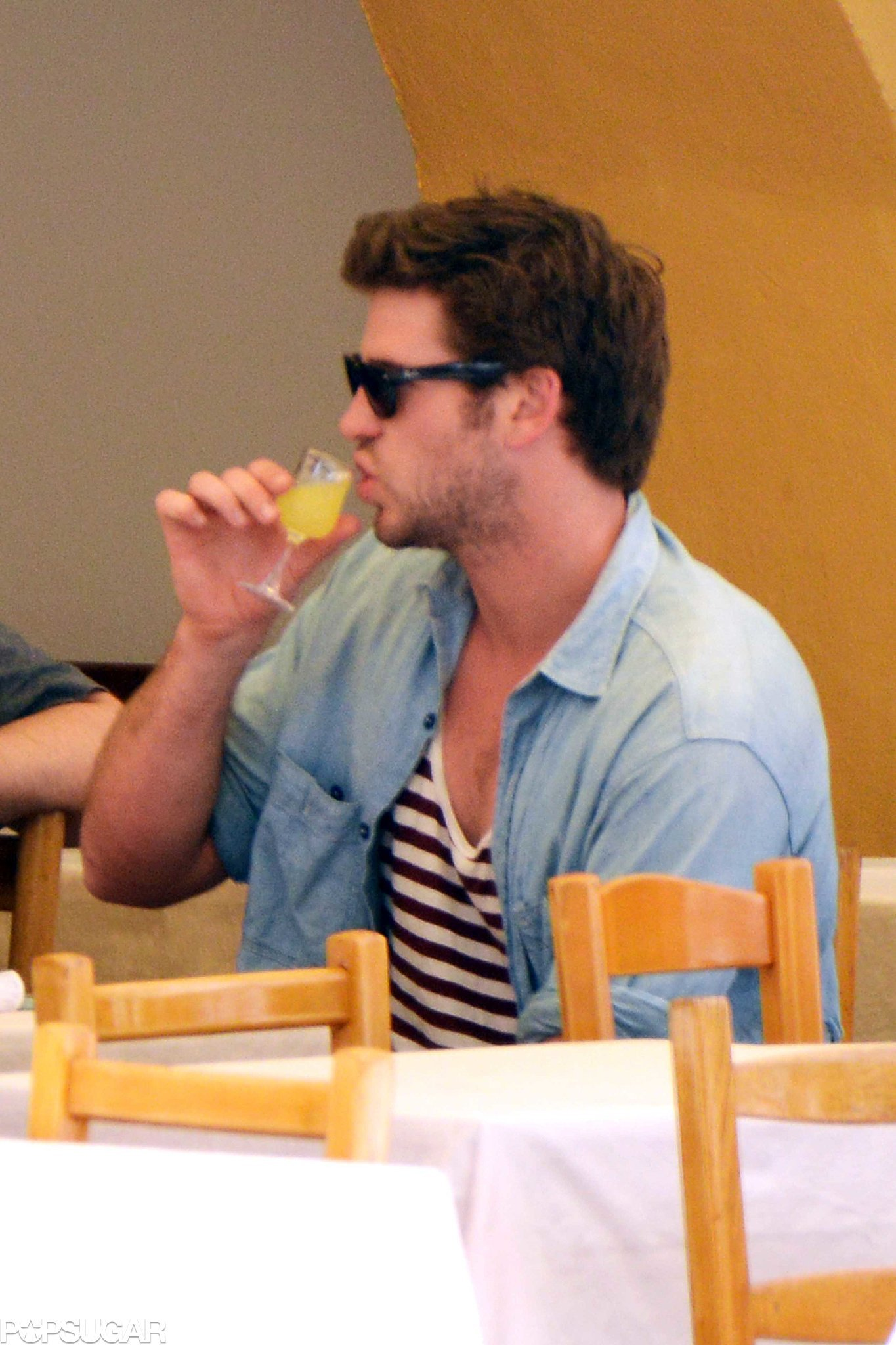 Liam Hemsworth Tastes the Life of Luxury From His Tiny, Tiny Glass