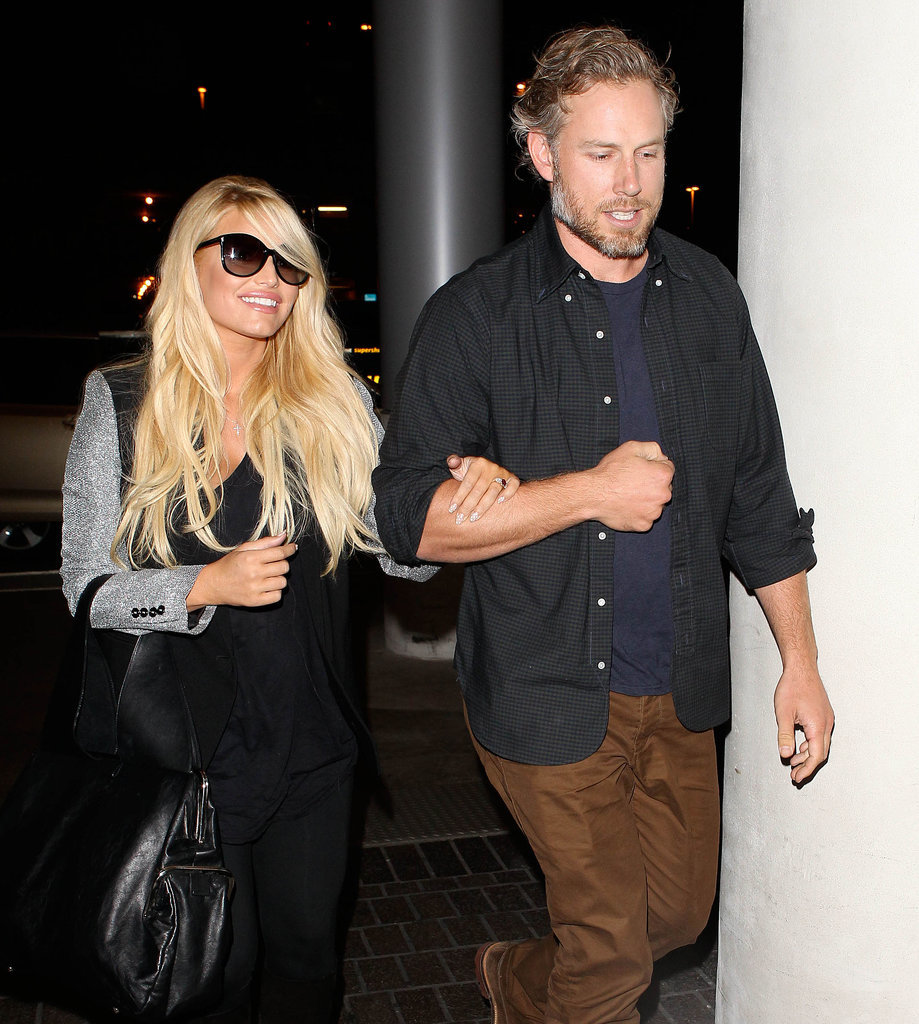 Jessica held on to her man as they made their way through LAX in November 2013.