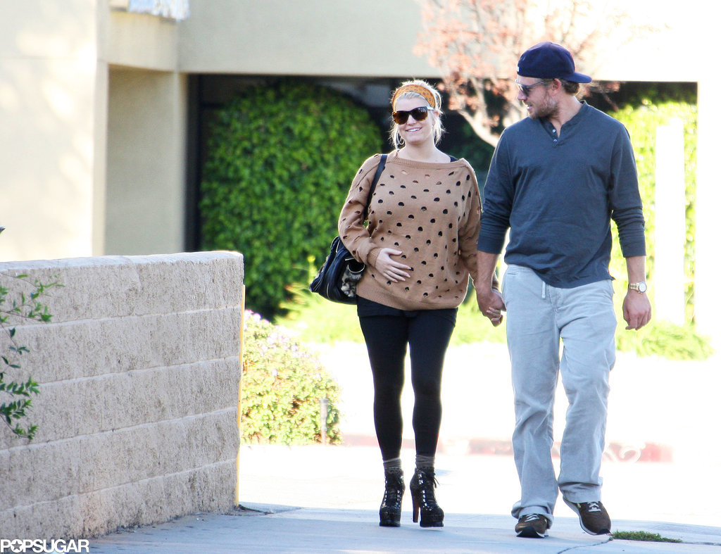 Jessica Simpson and Eric Johnson walked side by side to their car in LA in October 2011.