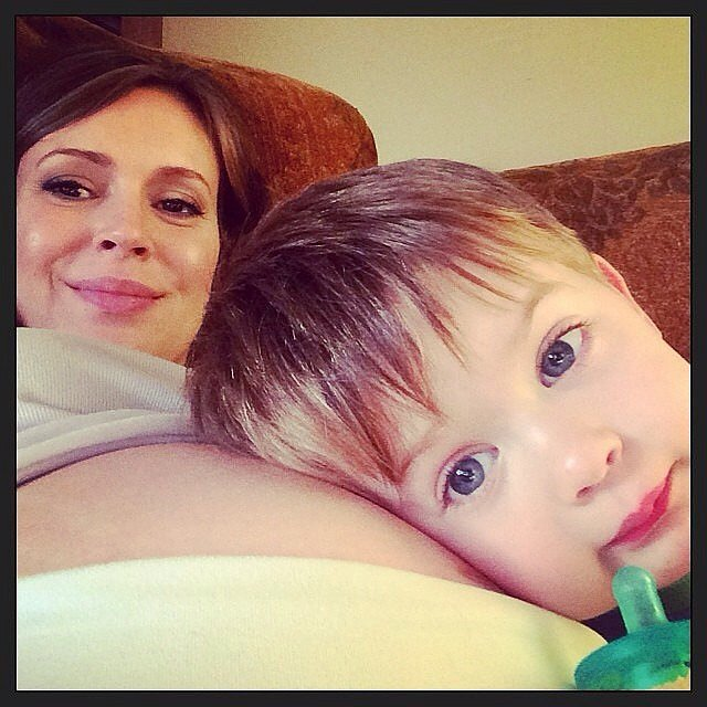 Milo Langdon took a rest on Alyssa Milano's pregnant belly. Source: Instagram user milano_alyssa