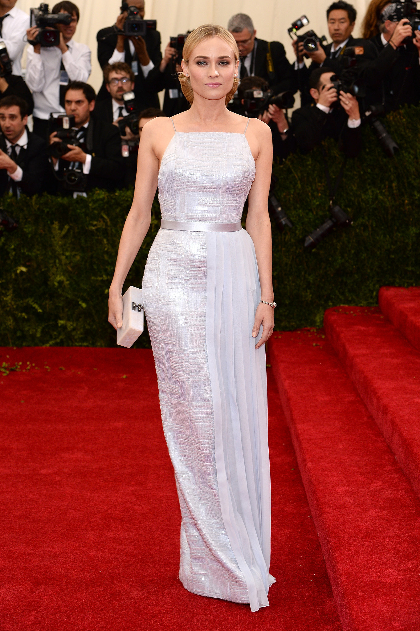 At the 2014 Met Gala, Diane stood out on the red carpet donning an embellished-panel Hugo Boss gown in a cool lilac hue.
