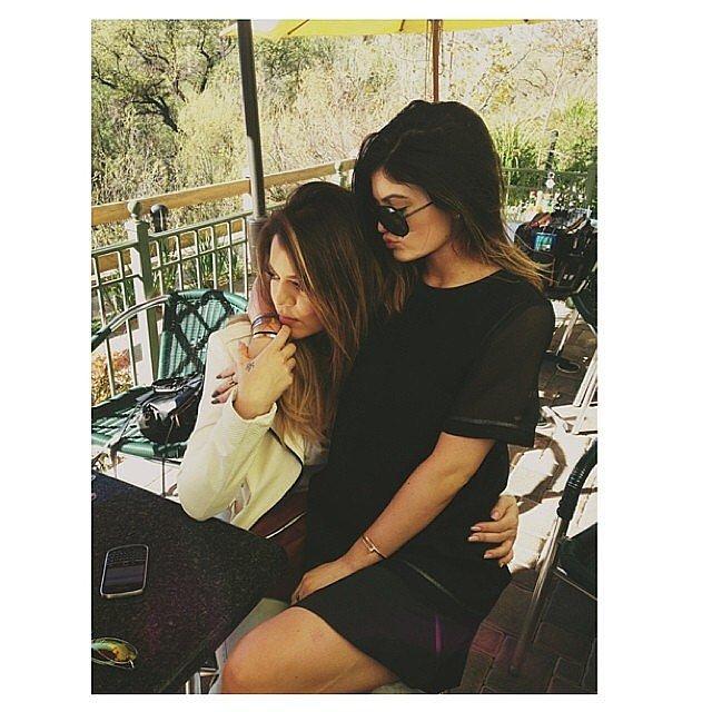 Kylie Jenner sat on Khloé Kardashian's lap. Source: Instagram user khloekardsahian