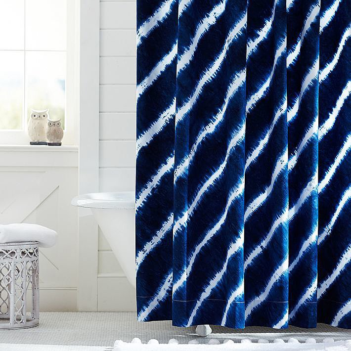We especially love the idea of introducing pattern to the bathroom with an eye-catching shower curtain. This Tie Dye Shower Curtain ($69) does the trick.