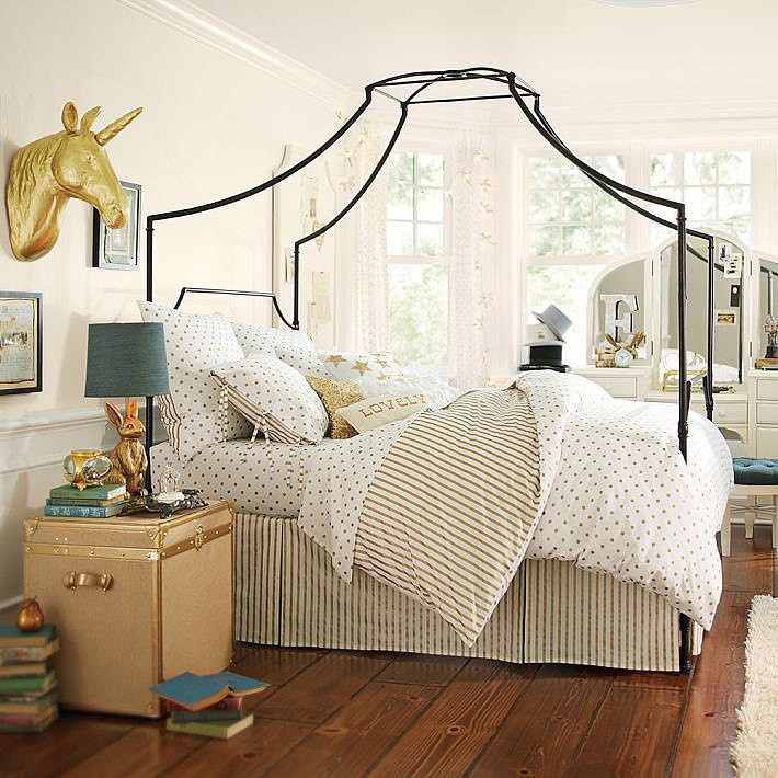 We're envisioning this Maison Canopy Bed ($549-$799, originally $699-$999) dressed in simple white linens.