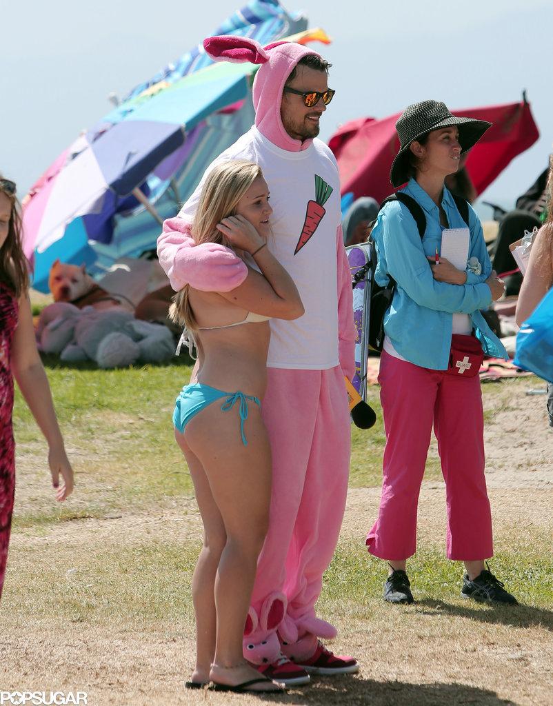 He Poses With Girls in Bikinis