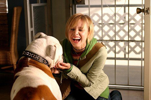 She also has the ultimate sidekick: her dog, Backup. Source: Warner Brothers