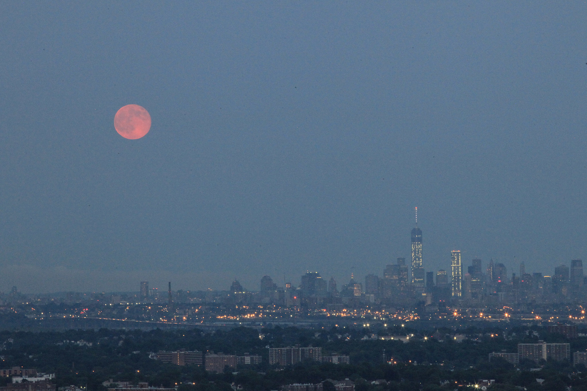 The supermoon shines over the New York City skyline on July 12.