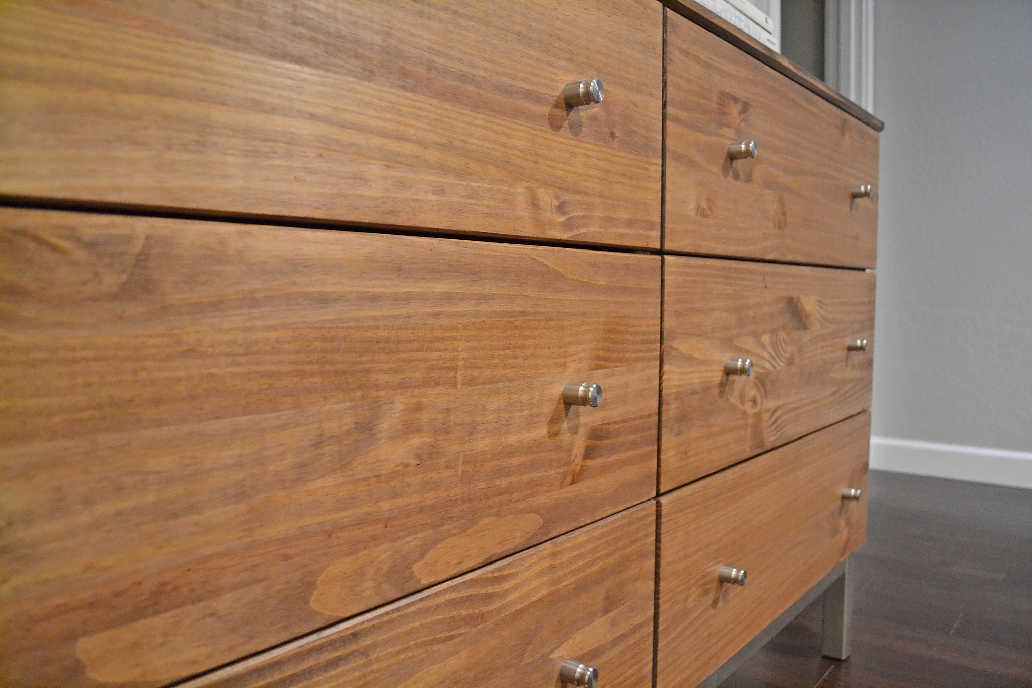 Next, she replaced the Ikea knobs with these stainless steel beauties from Room & Board. Photo: Lauren Turner