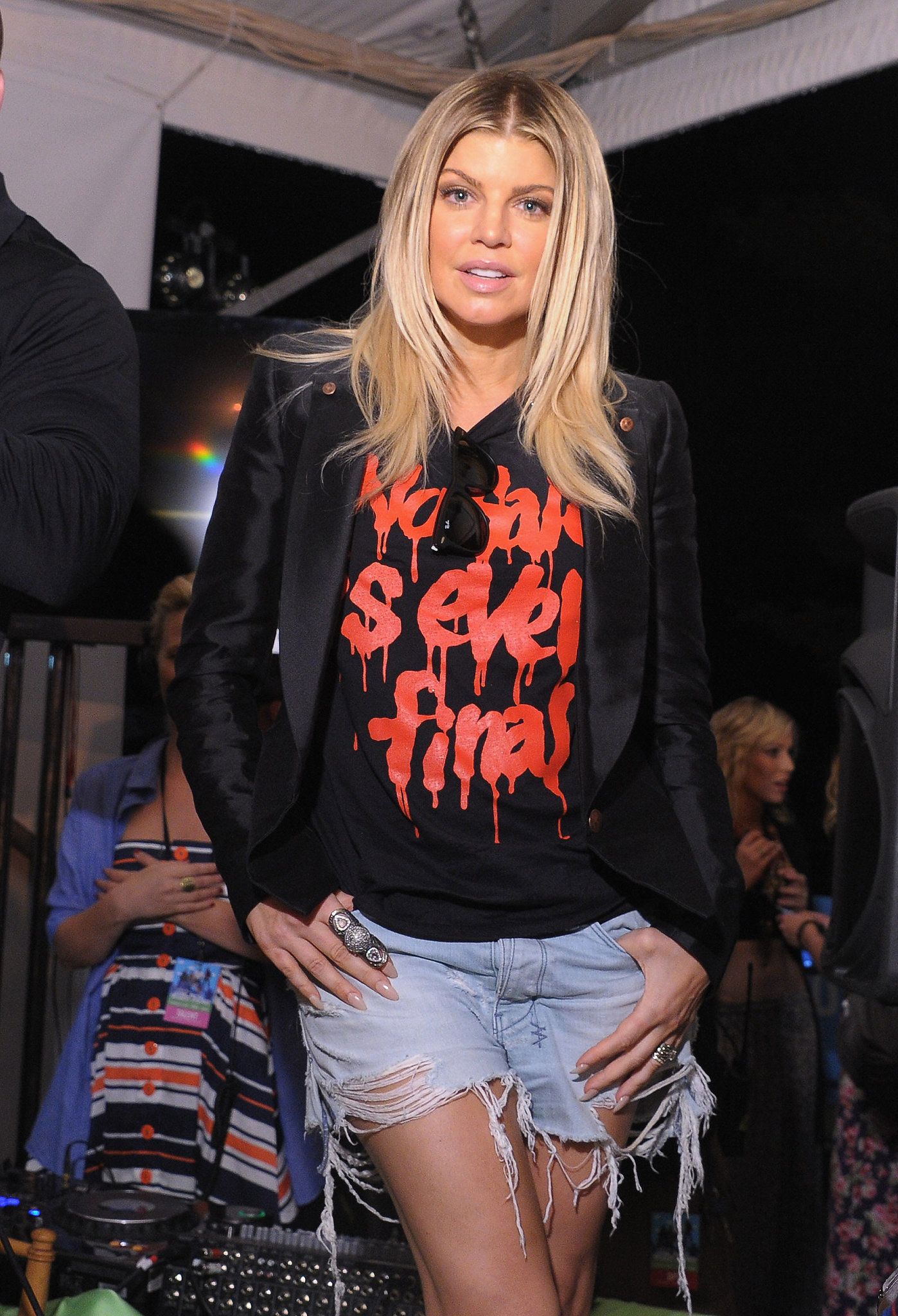 This is the all out cool-girl version of cutoffs: Fergie rocks hers with a blazer and a graffiti-print tee — reminding us that cutoffs were made to be paired with our favorite vintage tees.