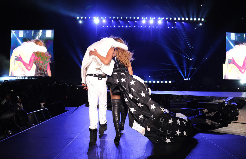 """They kept their arms around each other while heading off stage during their """"On the Run"""" show in New Jersey in July 2014."""