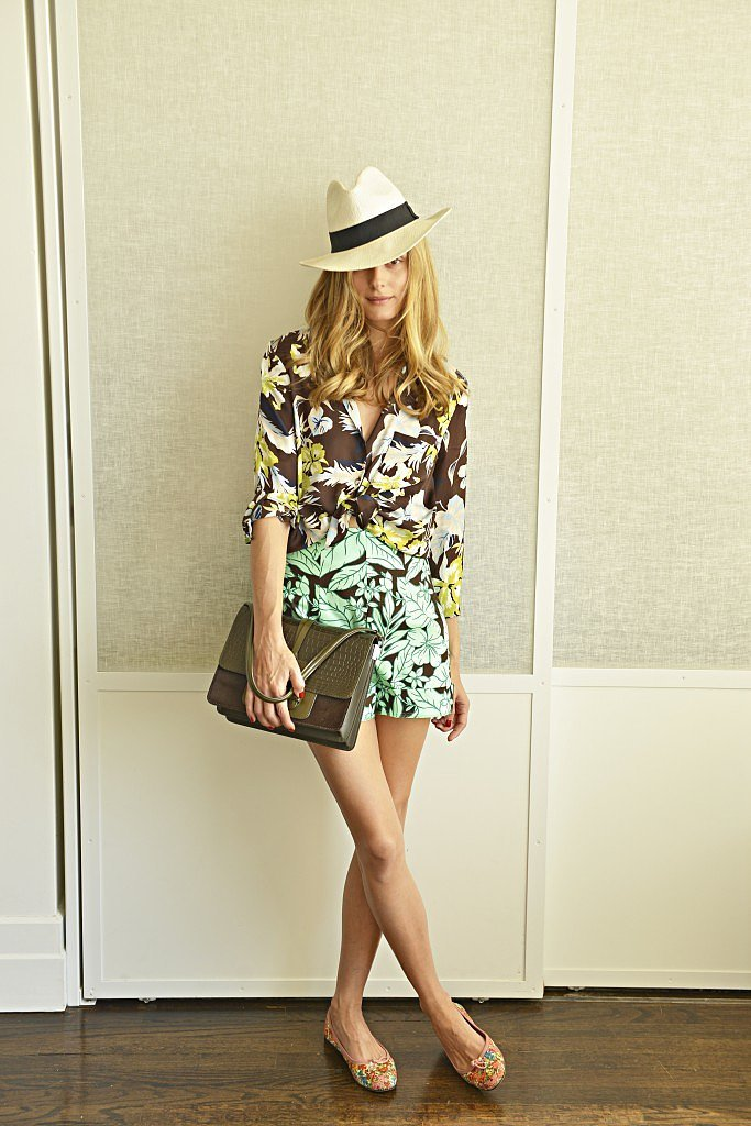Why not double up on a wash of beautiful florals? That's exactly what Olivia did with this botanical look, adding a printed blouse to her tropical high-waisted shorts. To break up the bold prints, she carried a solid clutch then added a playful, feminine touch with her floral-embellished ballet flats.  Source: Olivia Palermo