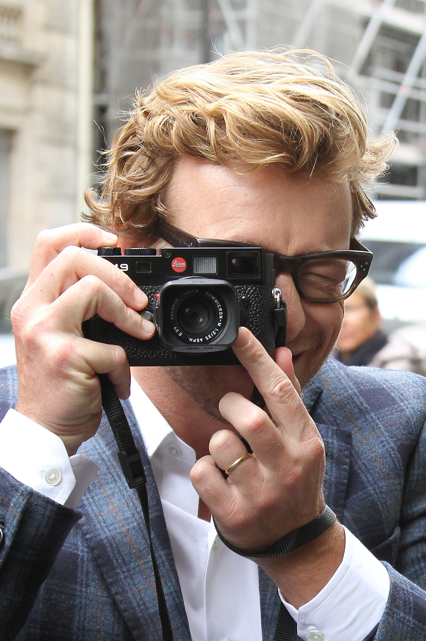 Here he is taking your photo after telling you how gorgeous you look today.