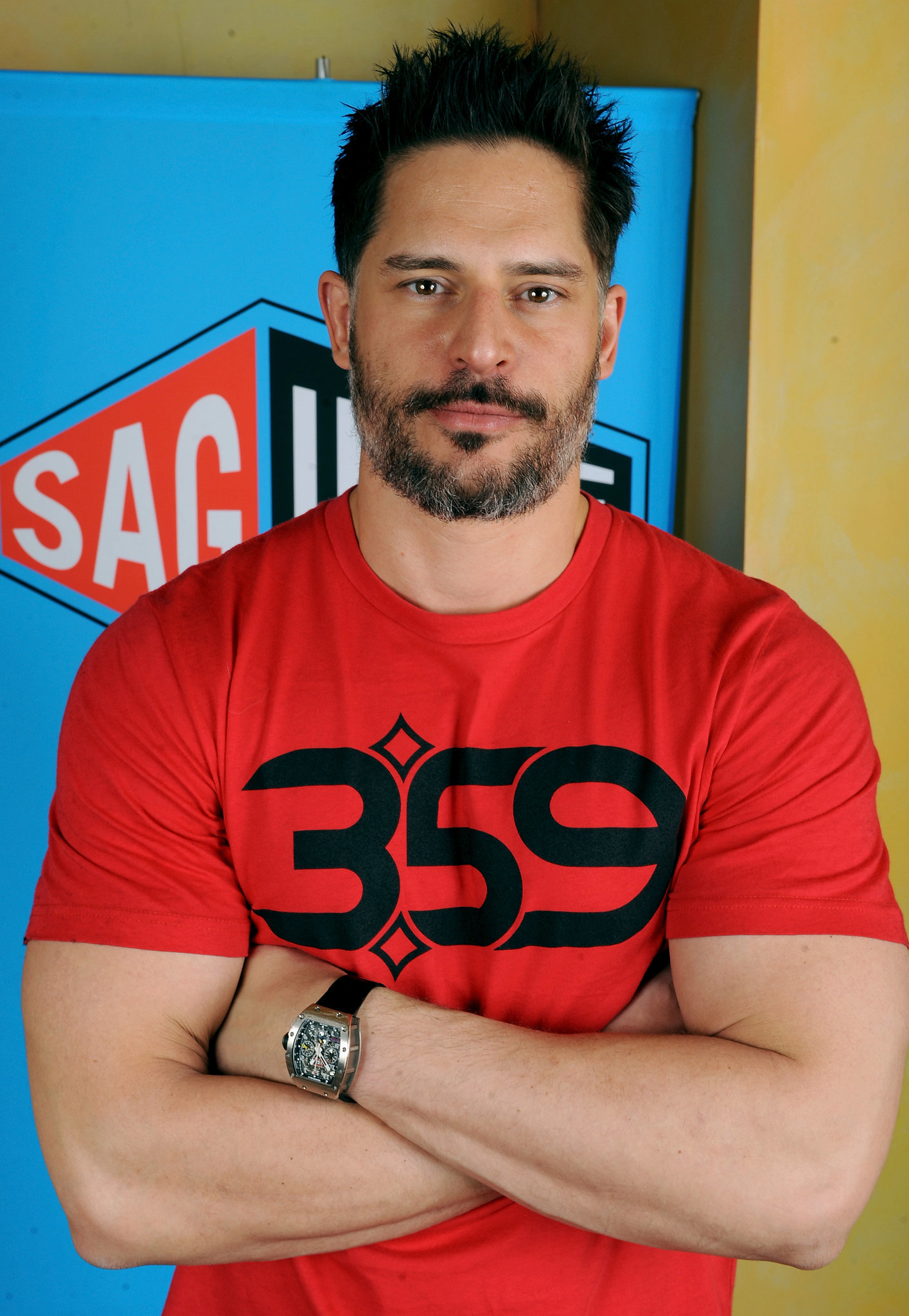 Here's Joe Manganiello and his biceps, which are actually strangling his sleeves.