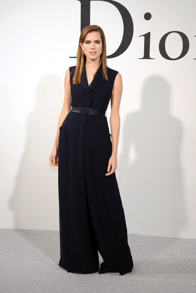 Allison attended Christian Dior's 2015 cruise show in a slightly androgynous oversize jumper, which she balanced with a cinched waist and elegant earrings.