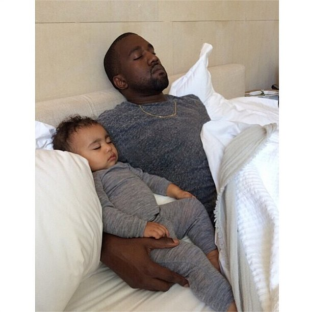 Kim captured a sleepy moment between North and Kanye on North's first birthday in June 2014.
