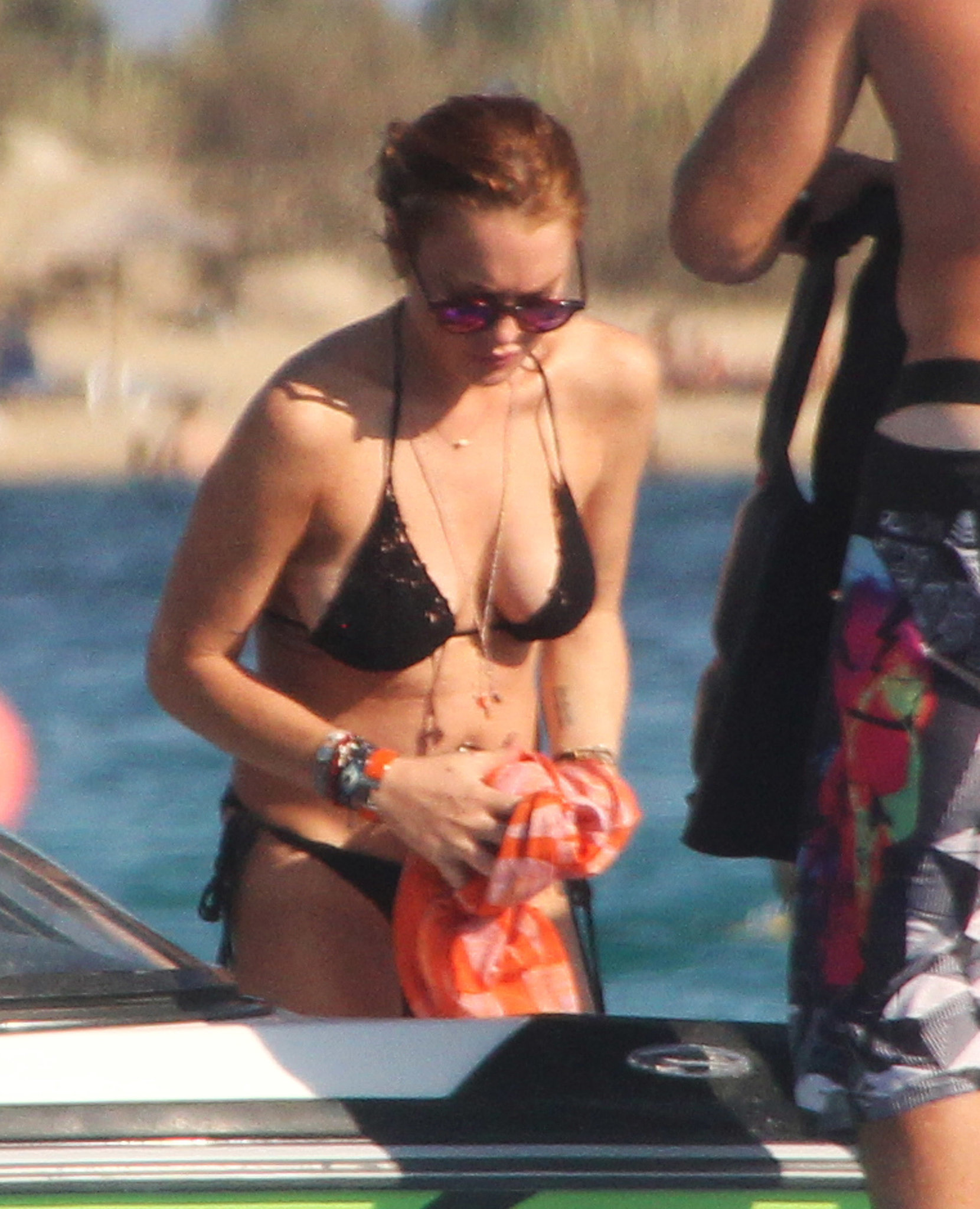 Lindsay Lohan's Latest Bikini Stop Hopefully Comes With Less Drama