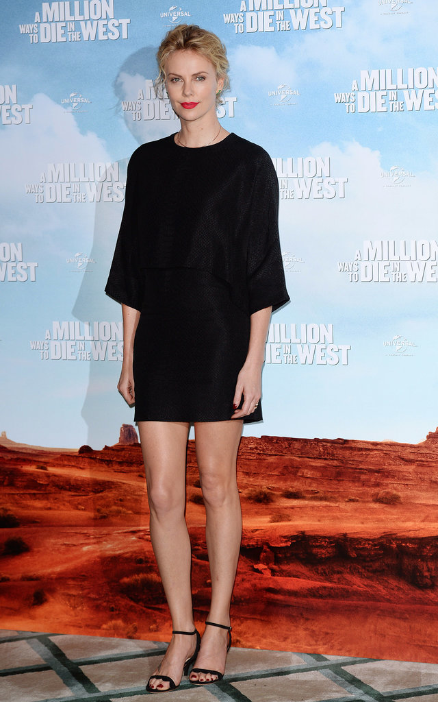 Charlize's effortless beauty makes a simple black tunic and mid-rise, strappy heels seem all the more classic.