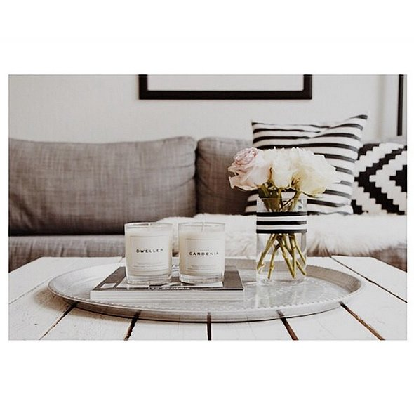 For a more modern look, keep your coffee table monochromatic. Layering pieces that are the same color looks luxe and sophisticated. Source: Instagram user interiorforinspo