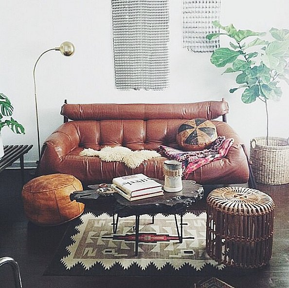 Keep with a theme — this bohemian-inspired living room is full of eclectic pieces that all fit together, including the live-edge table.  Source: Instagram user americangarage