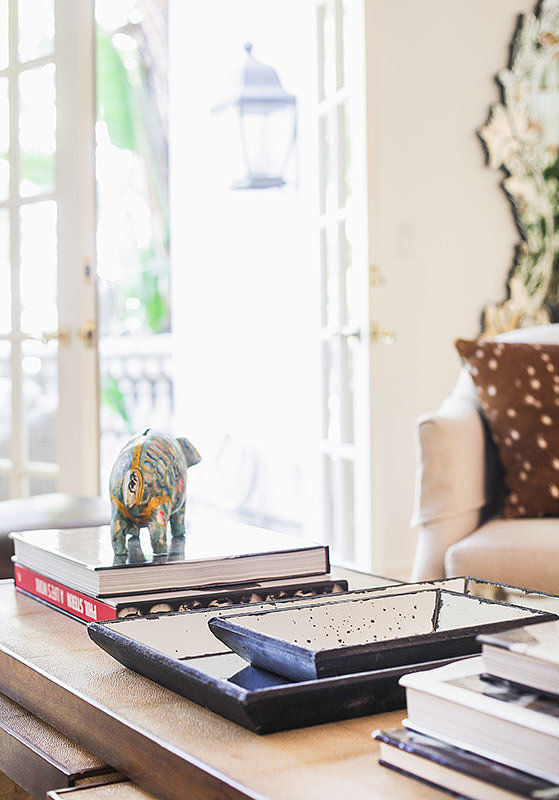 Showcase treasures without overcluttering by stacking items neatly. Photo by Tessa Neustadt. via Homepolish