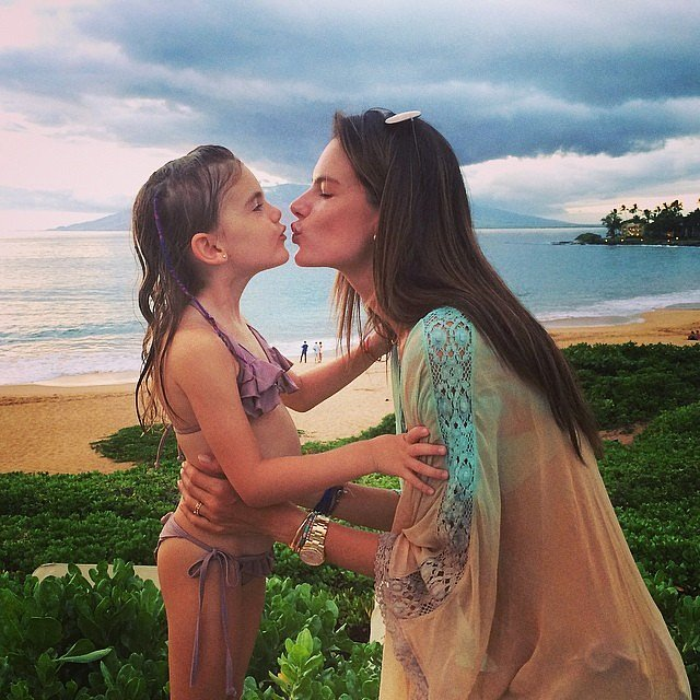 Anja and Alessandra shared a sweet kiss in front of their incredible view. Source: Instagram user alessandraambrosio