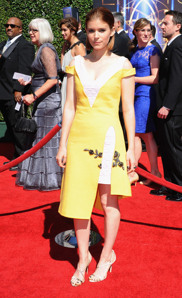 Kate Mara wore a yellow-and-gold dress.