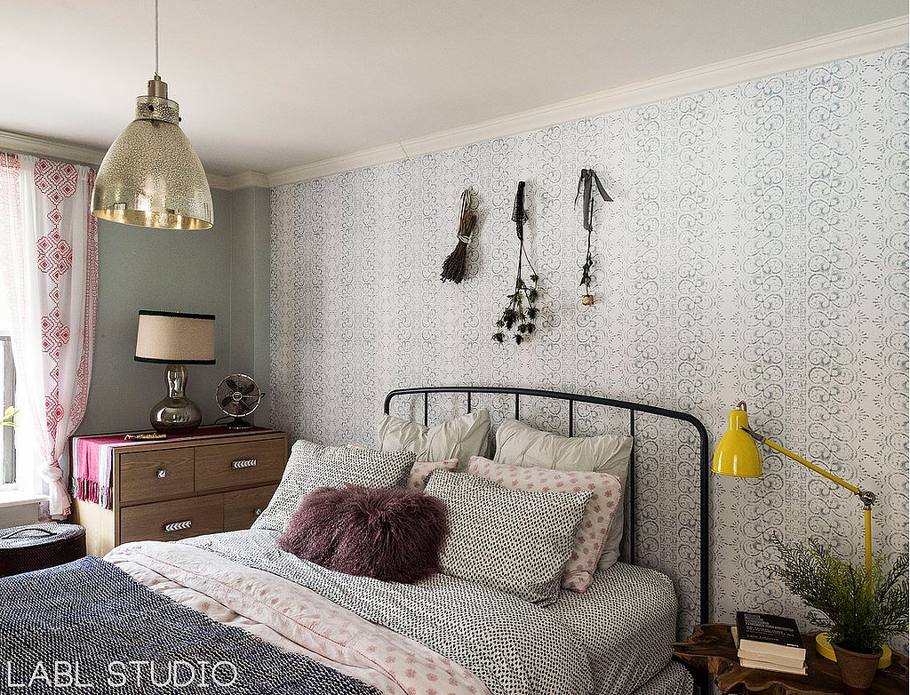 The mixed patterns in the bedroom feel subtle and soothing, thanks to the coordinated colors.