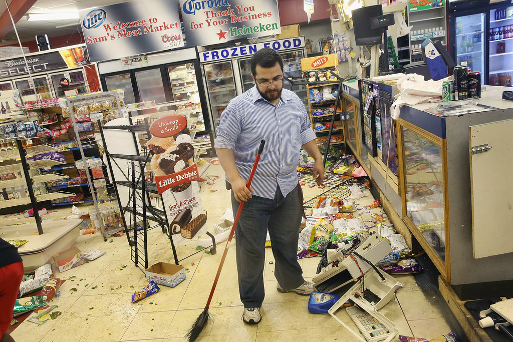 A business owner cleaned up his market after riots broke out in Ferguson, MO.