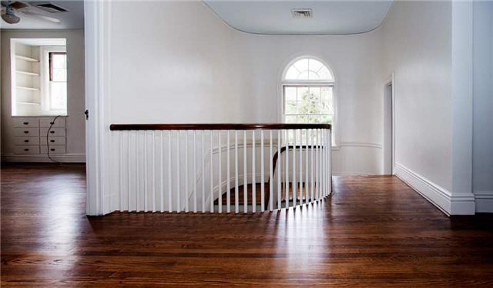The beautiful bannister on the stairs is a dead giveaway to the home's 1930s construction.  Source: Zillow