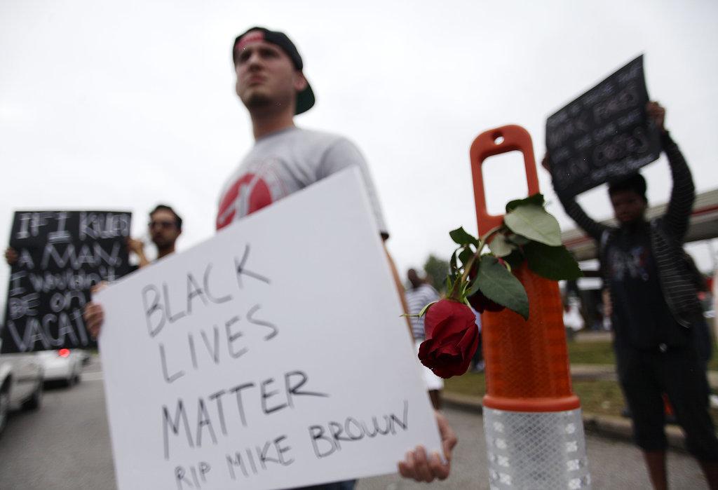 Protestors held signs demanding justice for Michael Brown.