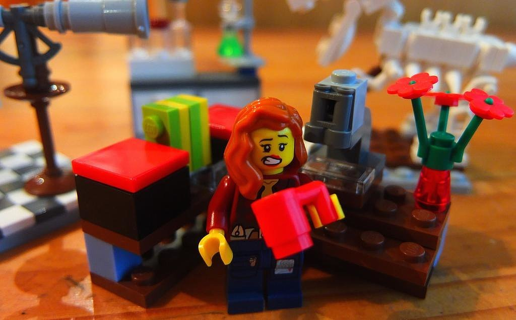 """Dr. Red quickly downs her 4th cup so she won't miss coffee with a coauthor followed by the coffee break team meeting."""