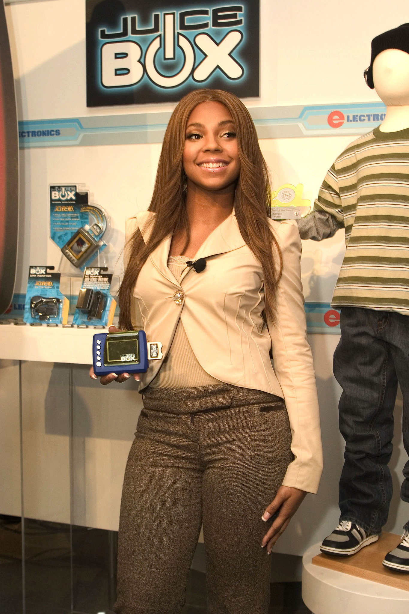 """""""Princess"""" Ashanti probably wrote a secret ballad about the Juice Box MP3 Player she loved so much."""
