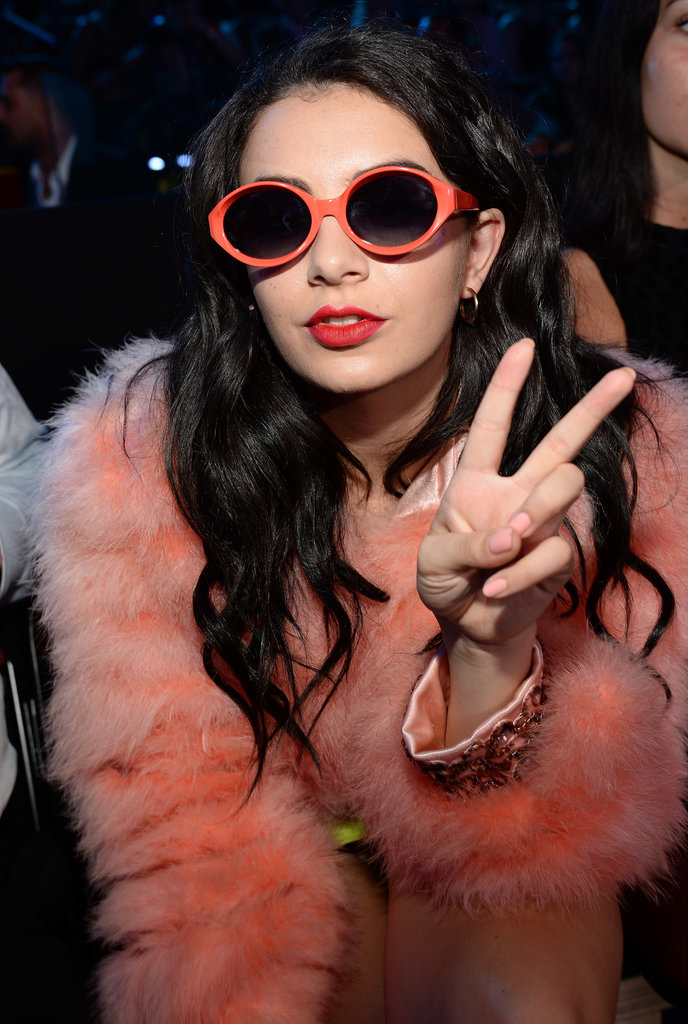 Later on in the evening, Charli XCX slipped on these funky peach sunglasses to complement her fur coat.