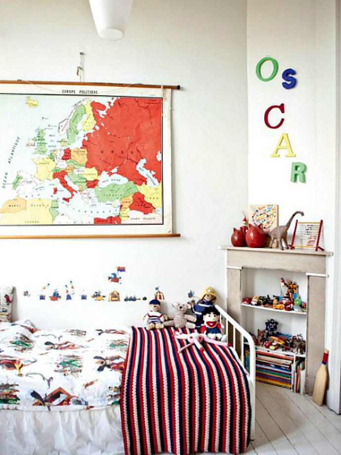 Oscar's room as shown in Milk Magazine: Different sized, multicolored letters spell out Oscar's name loud and clear in this beautiful Brussels-based bedroom. I love the color palette created by Oscar's parents, French photographer Vincent and Justine Glanfield (of Cotton & Milk fame). The old-school map and lettering have a unifying effect on this simple space, packed with a jumble of toys, patterns, and vintage accessories. For a similar look, check out specialist stores like Kidimo, or scour your local flea markets until you find your unique combination of letters!
