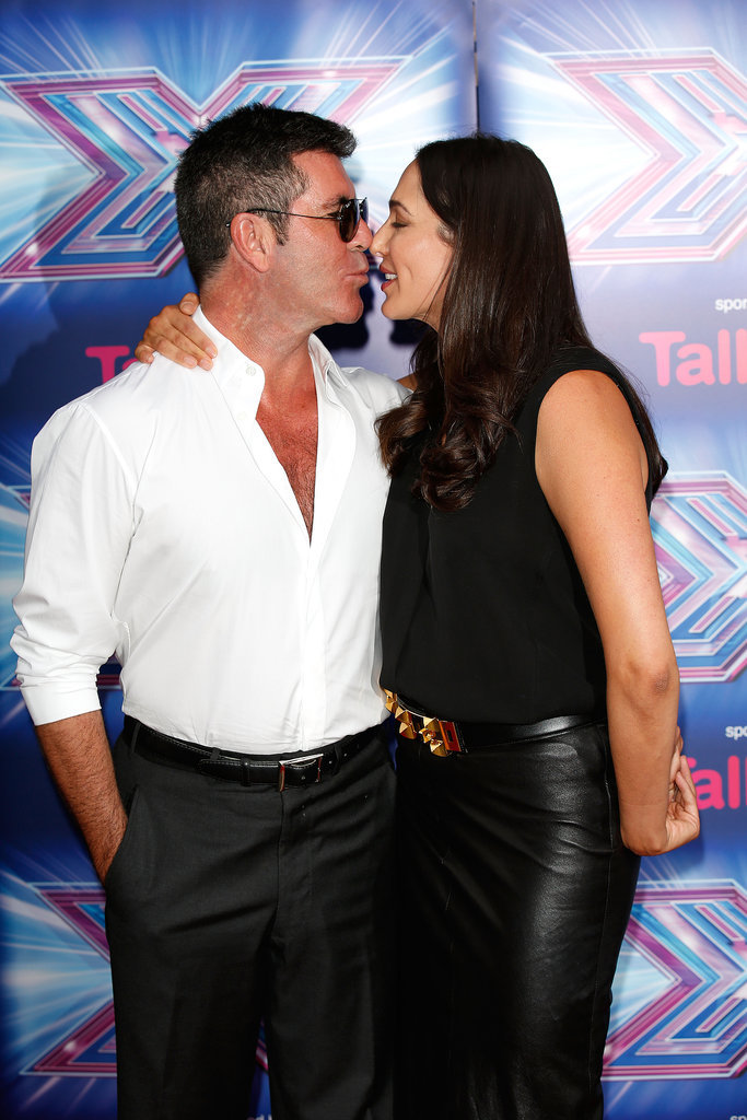 On Wednesday, Simon Cowell and Lauren Silverman shared a kiss at a press event for The X Factor in London.
