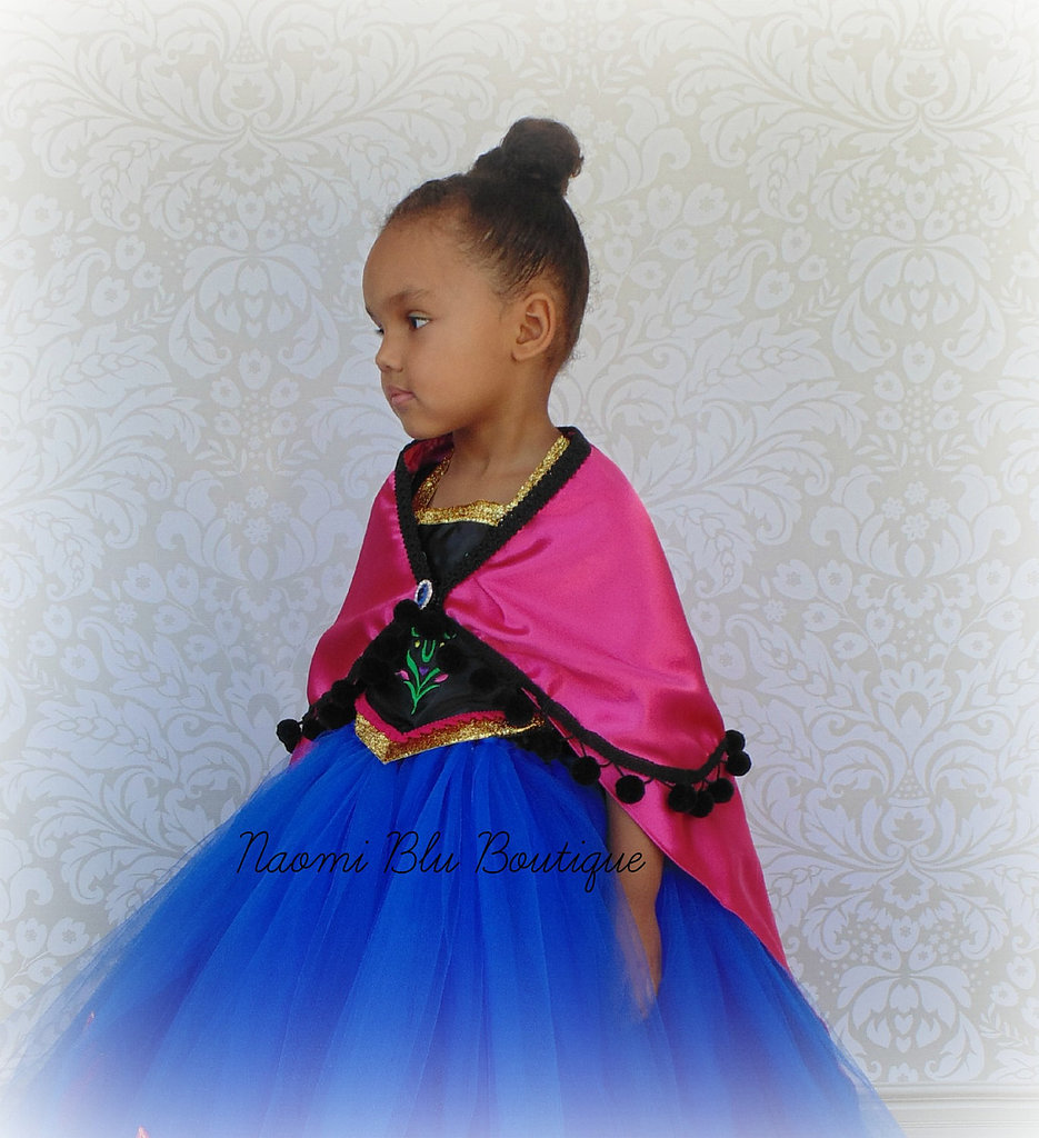The cape that Anna dons after Elsa's coronation ball is one of the prettiest pieces in the entire Frozen movie, so it's important to nail it this Halloween. Try this handmade cape ($38) paired with this take on Princess Anna's dress ($70) from the same shop.
