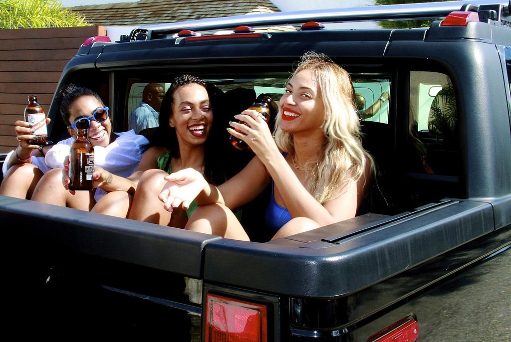 Beyoncé kicked back with a beer while hanging out with her sister and cousin in Jamaica in December 2013.
