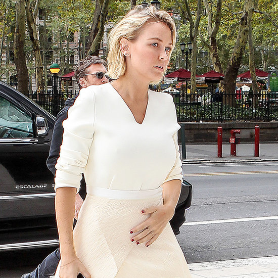 Lara Bingle Pictures Touching Stomach in NYC