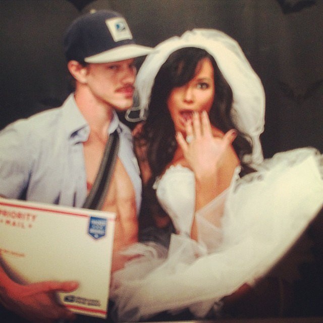 """Newlyweds Naya Rivera and Ryan Dorsey, who tied the knot in a secret wedding in July 2014, got cheeky in their """"mail-order"""" bride and mailman outfits that year."""