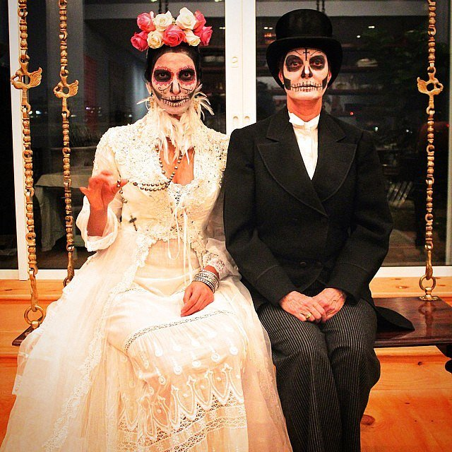 Padma Lakshmi and Susan Sarandon dressed as Newlywed Ghouls in 2014.