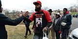 Michael Brown's Father Delivers Turkeys To Ferguson Citizens