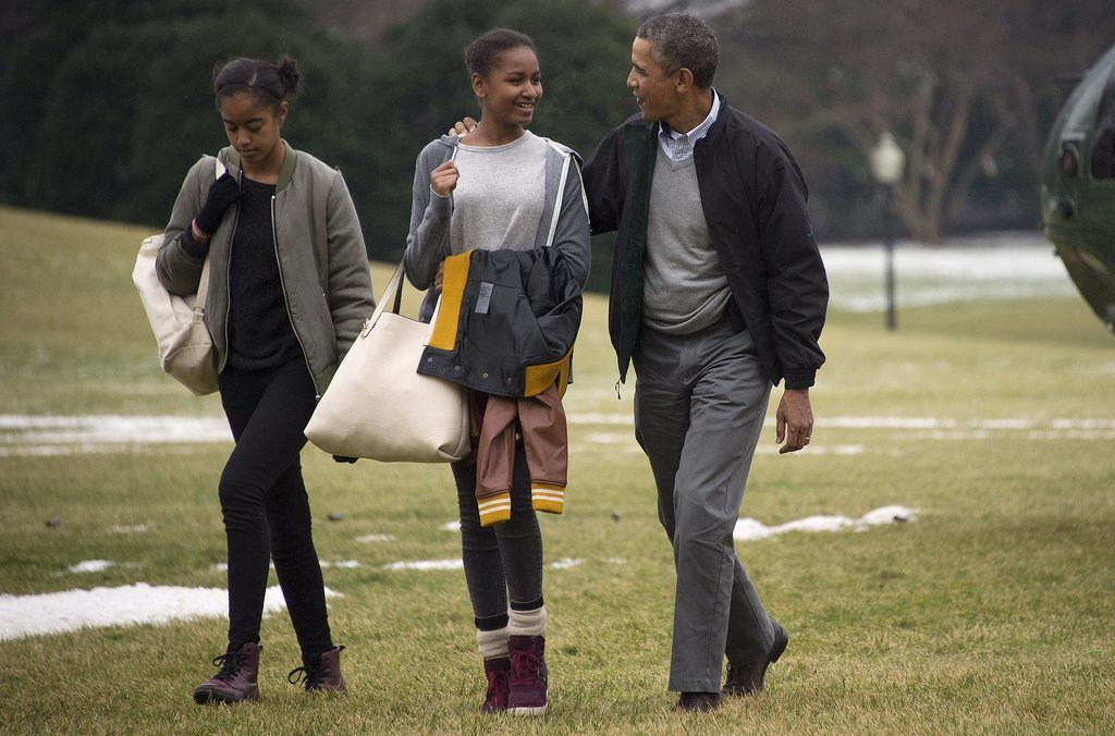 President Obama had his arm around Sasha when he and his daughters returned from their Hawaii trip in January.